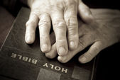 Hands on the bible — Stock Photo