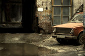 Yard with old car — Stock Photo