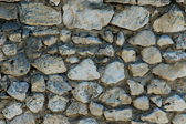 Old wall made from natural stones — Stock Photo