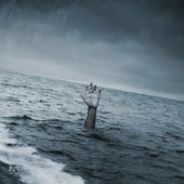 Hand of the man in the sea, asking for help — Stock Photo
