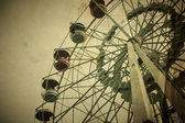 Aged vintage photo of carnival ferris wheel — Stock Photo