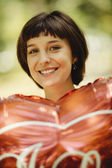 Happy woman with red balloon — Stock Photo