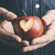 Hands with apple — Stock Photo #38577411