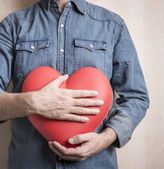 Man with big red heart — Stock Photo