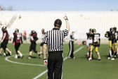 American football referee with hand up — Stock Photo