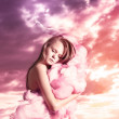 Stock Photo: Girl on pink clouds