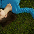 Young woman lying in the grass — Stock Photo #12078536