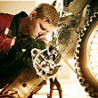 Man repairing a sports bike - Stock Photo