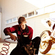 Stock Photo: Mrepairing sports bike