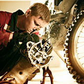 Man repairing a sports bike — Stock Photo