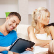 Couple with tablet PC — Stock Photo #12550805