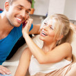 Happy couple at home - Stock Photo