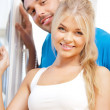 Happy couple at the window — Stock Photo #12592003
