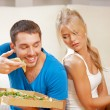 Couple eating different food — Stock Photo #12592180
