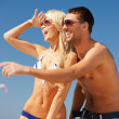 Happy couple in sunglasses on the beach — Stock Photo #12592242