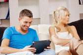Couple with tablet PC — Stockfoto