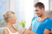 Romantic couple with flowers — Foto de Stock