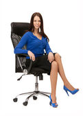 Businesswoman sitting in chair — Stock Photo