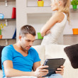 Couple with tablet PC — Stock Photo #12619809