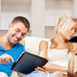 Couple with tablet PC — Stock Photo #12619820