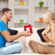 Happy romantic couple with gift — Stock Photo #12619894