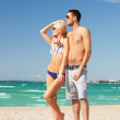 Happy couple in sunglasses on the beach — Stock Photo #12619998