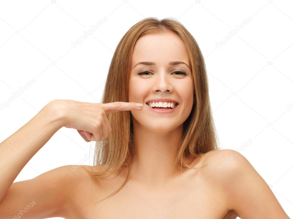 Picture of beautiful woman pointing to teeth — Stock Photo #12620918