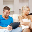 Couple with tablet PC - Stock Photo