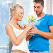 Romantic couple with flowers — Stock Photo #12664776