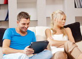 Couple with tablet PC — Stock Photo