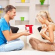 Happy romantic couple with gift — Stock Photo #12675480