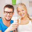 Couple holding energy saving bulb — Foto de Stock