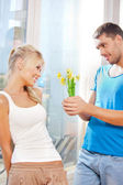 Romantic couple with flowers — Stock Photo