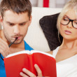Couple at home with book — Stock Photo