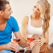 Romantic couple drinking wine - Stock Photo