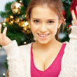 Woman decorating christmas tree — Stock Photo #12885097