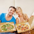 Romantic couple eating pizza at home — Photo