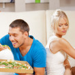 Couple eating different food — Stock Photo #12885635