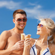 Happy couple with ice cream — Stock Photo