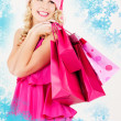 Cheerful santa helper girl with shopping bags — Photo