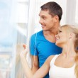 Happy couple at the window — Stock Photo #12953259