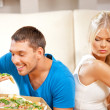 Couple eating different food — Stock Photo #12954279