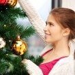 Woman decorating christmas tree — Stock Photo #12959722