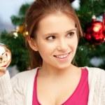Woman decorating christmas tree — Stock Photo #12959868