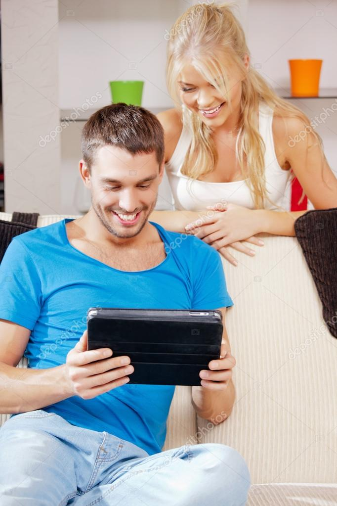 Bright picture of happy couple with tablet PC — Zdjęcie stockowe #12952826