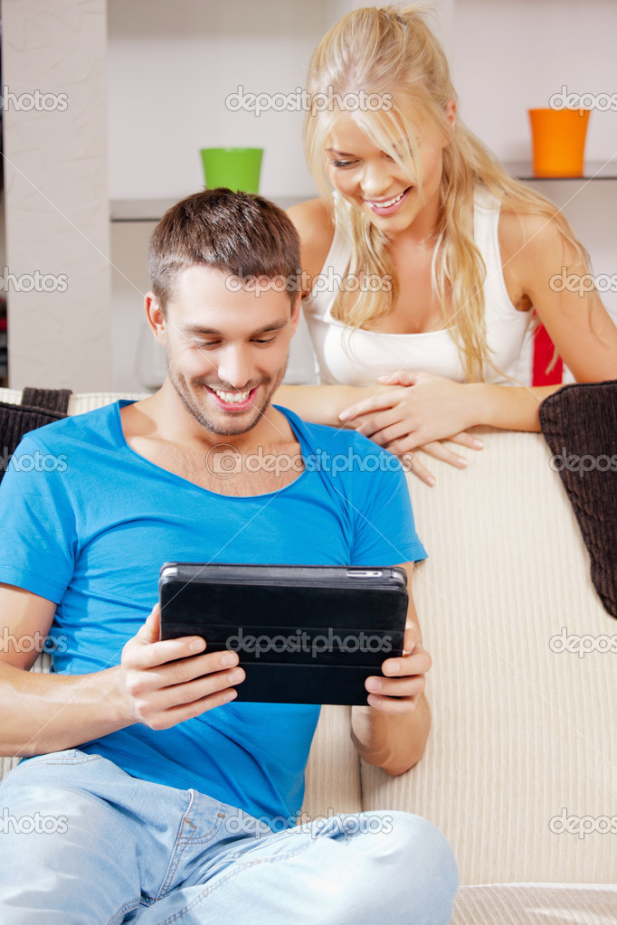 Bright picture of happy couple with tablet PC  Foto Stock #12952826