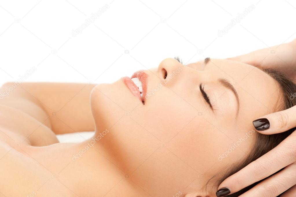 Picture of happy beautiful woman in massage salon  Stock Photo #12958110