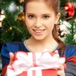 Happy woman with gift box and christmas tree — Stock Photo #12960117