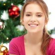 Happy and smiling woman with christmas tree — Stock Photo #13085903