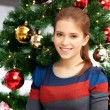 Happy and smiling woman with christmas tree — Stock Photo #13085919